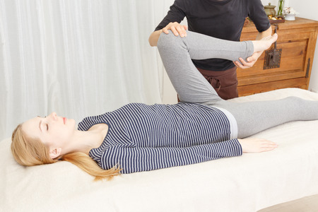 37229963 - caucasian woman undergoing a chiropractic