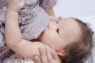 30521050 - asian mom breast feeding her baby girl